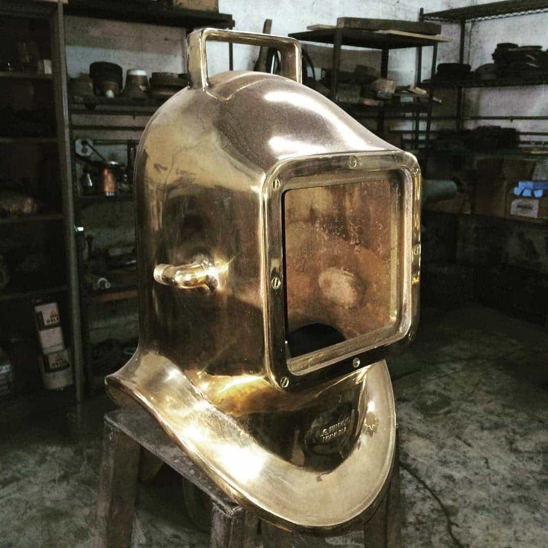 A polished brass dive helmet.